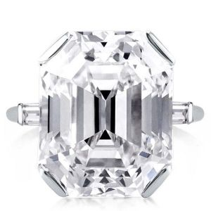 three stone emerald cut four prong engagement ring